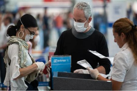 coronavirus barbijos aeropuerto