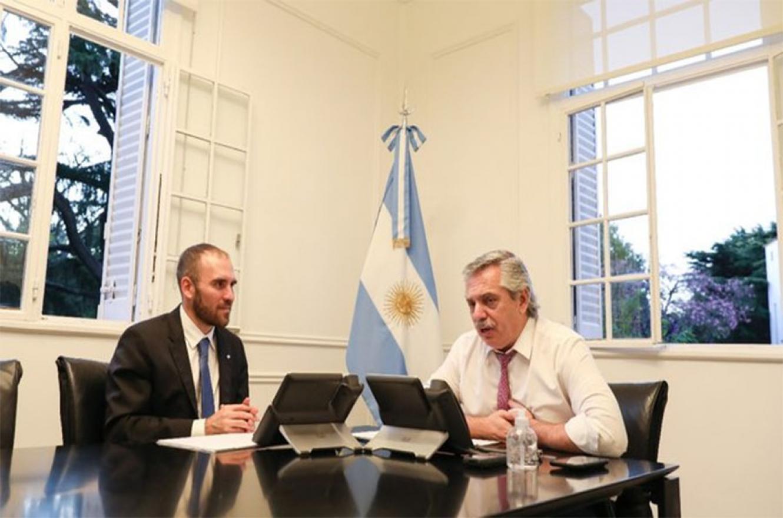 Fotografía de archivo del ministro de Economía, Martín Guzmán y del Presidente Alberto Fernández.