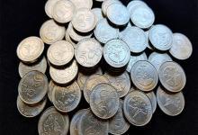 monedas de cinco pesos